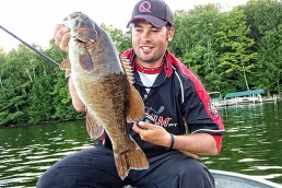 Andrew Ragas with big summer smallmouth bass