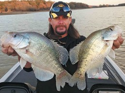 Crappie pro Todd Huckabee with two monster crappies
