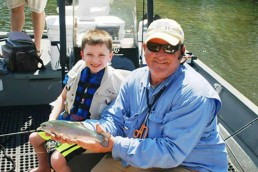 Vincent Triantaflos with guide Steve Dickey who put the grandchildren on hot fishing holes in Lake Taneycomo.