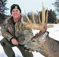 Late season is Todd Amenrud's favorite time to hunt mature bucks. Here, he poses with a buck he killed.