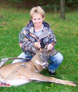 Lisa's first-ever deer with her bow was a nice 'forked' buck she arrowed from a treestand behind her house.