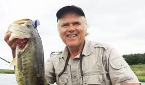 Swimming a 1/4-ounce Dragon Hopper with a 2/0 sprout worm hook and Texas-rigged Pit Boss Jr. over heavy coontail weeds, help produce this lunker bass as the lure dropped on a fall over the outer edge of a weedline.