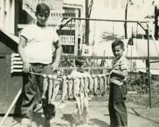 Petros at age 14, with trout caught from the tank at the Chicago Ampitheater Show.