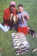 Petros with his grandson, Spencer, and a catch of Illinois panfish.