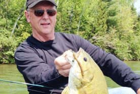 Joe Bucher with a monster smallmouth that fell for a well-presented wacky jig.