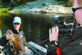 MidWest Outdoors TV Producer Matt Pollack captures the action on Crane Lake with host Scott Walsh. Photo: Roger Cormier