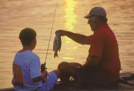 Young anglers are told at an early age to return some fish they have caught.