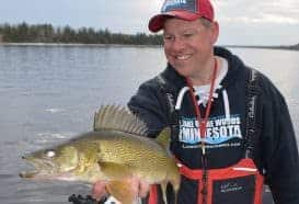Joe Henry with a nice Rainy River walleye. A subtle adjustment of working the boat into the current with the jig well behind the boat fished horizontally vs. vertically put more fish in the boat.