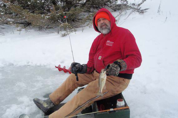 Old-fashioned Ice Fishing Still Puts Fish on the Plate