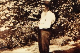 Old fashioned photo of a bearded fisherman with a 60-year-old rod and reel.