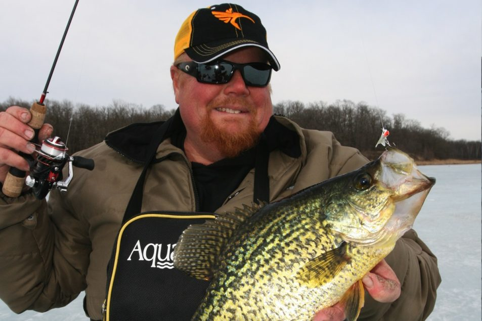 """Ice fisherman Brian """"Bro"""" Brosdahl with a large crappie caught from under the icy lake."""