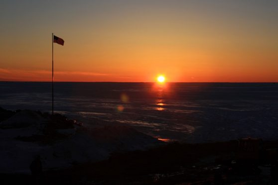 Spectacular sunset over the ice at Arensen's Resort, a destination for ice-fishing Lake of the Woods.