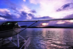 Float plane on the water at sunset over Cree Lake.