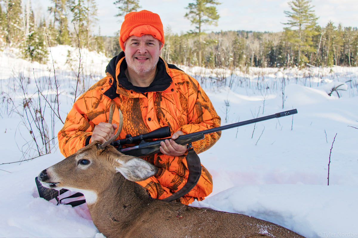 7d78bf1ae73ec Deer hunter in the snow with small