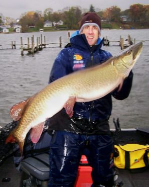 Fisherman Ryan Stochl with a near-state-record 50.75-inch muskie caught on the Fox Chain of Lakes.