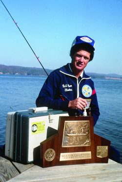 Pro fisherman Rick Clunn with his 1976 trophy plaque for winning the Bassmaster Classic.