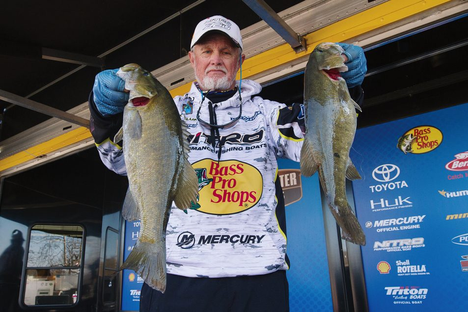 Rick Clunn has been hooking huge bass his entire life. Here, he displays two fine catches of the day.