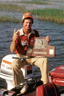 Pro fisherman Rick Clunn with his trophy plaque from winning his second conssecutive Bassmaster Classic