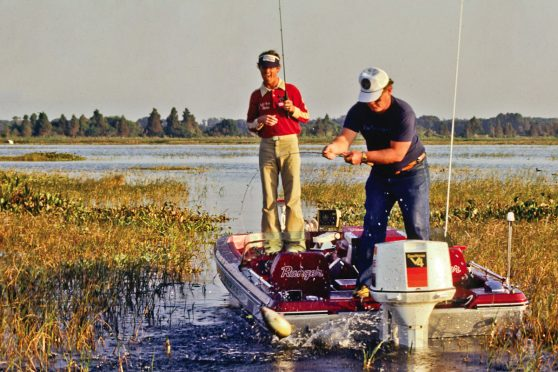 Rick Clunn fishing from a boat with his fishing partner in the seventies.