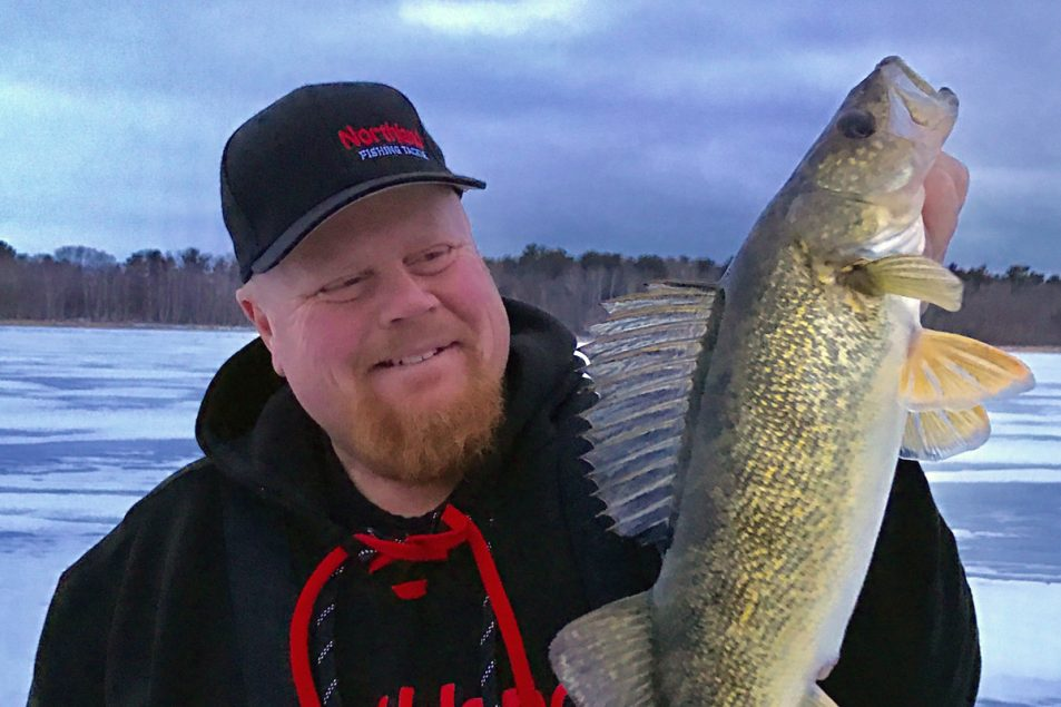 Brian 'Bro' Brosdahl displays a dandy walleye caught on deadsticks.