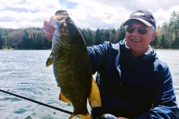 Author Joe Bucher displays a smallmouth pre-spawn bass freshly caught on a crankbait.