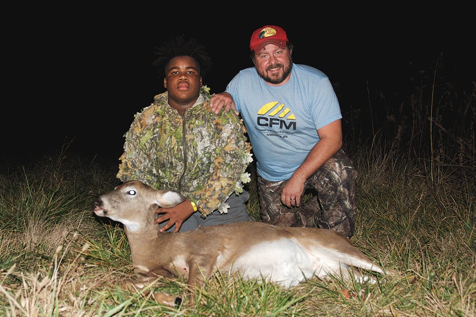 Chris Brown and Brandon Butler pose with a doe Chris took on his fifth deer hunt of the year.