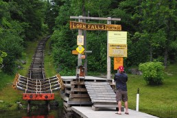 The mechanical portage at Loon Falls pictured here allows boaters to leave the Crane Lake Chain, be transported over land into adjoining Loon Lake, and enjoy other lakes. On the far end of Loon Lake, Beatty Portage mechanically transports boats into spectacular Lac La Croix.