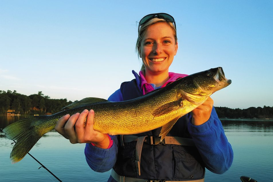Christina Sucharski with a nice walleye that ate a swimbait on a glass-calm morning.