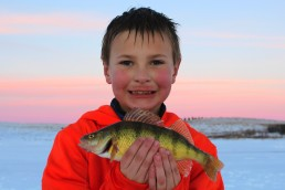 Lakes with abundant panfish are usually your first choices for when you take kids fishing. Action adds to the positive outdoor experience of ice fishing.