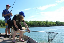 It's never too early to let kids learn how to net fish and helps ensure that everyone gets into the act on every catch. If you pick the right lake, you'll have lots of catches to help on!