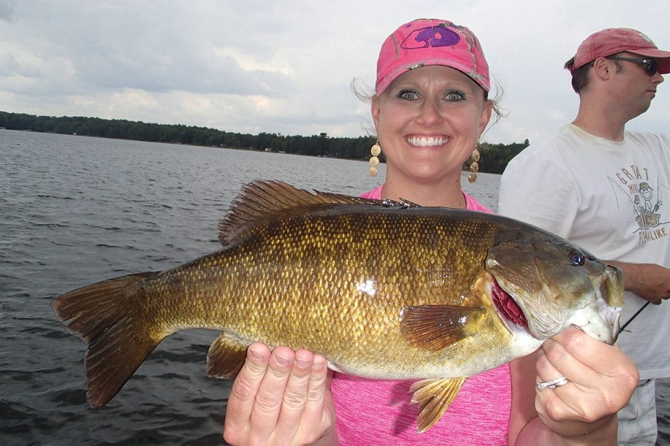 Never leave active bass to seek greener pastures elsewhere. Guide customer Andrea Luszcak displays one of more than 60 bass boated on this July day.